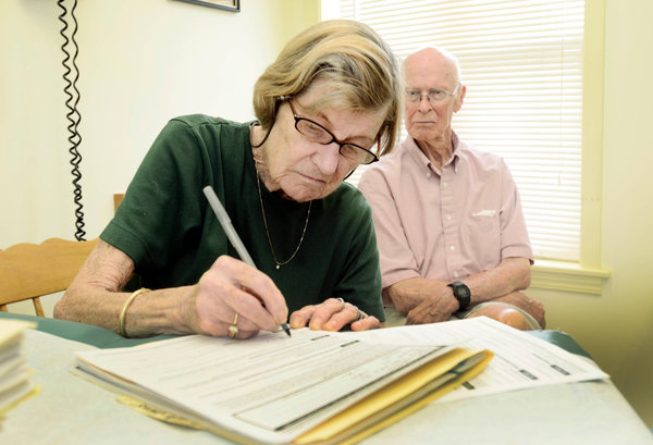 Janice Ryan signed a living will and health care proxy form in July 2014 with her husband, Richard, in Dundee, N.Y. Medicare proposed paying doctors for having conversations with patients about end-of-life care. Credit Heather Ainsworth for The New York Times