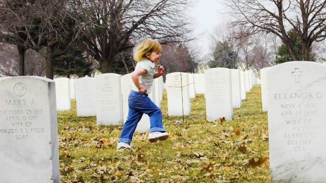 Children running through cemetary